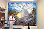 Sandra views a mural of 'what really happened'