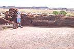 Sandra at big log near visitor center