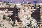People at Mather point - they toss coins out to the next rock